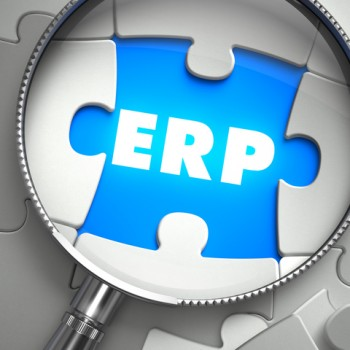 ERP- Enterprise Resource Planning - Puzzle with Missing Piece through Loupe. 3d Illustration with Selective Focus.